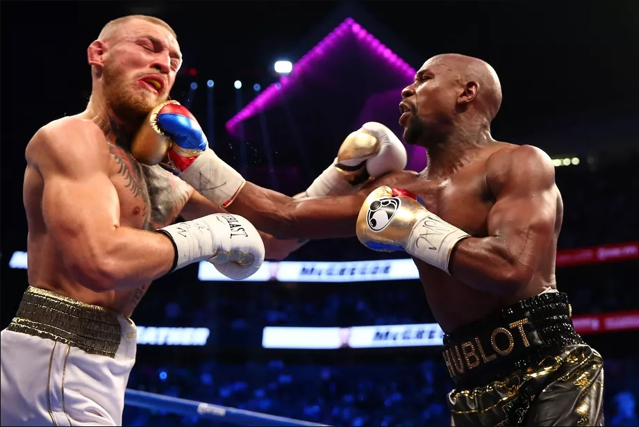 Floyd Mayweather gets his 50th win as he stops a gassed McGregor in the 10th Round. -