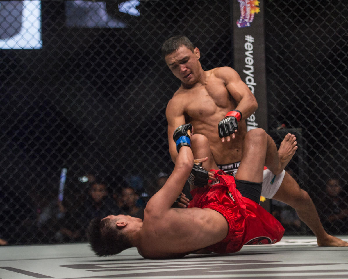 KAIRAT AKHMETOV SCORES SPLIT DECISION VICTORY OVER GEJE EUSTAQUIO at ONE FC TOTAL VICTORY -
