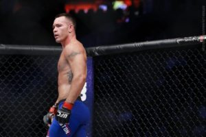 "Colby Covington defeats ""Tyquil"" Woodley in a pro-wrestling match -"
