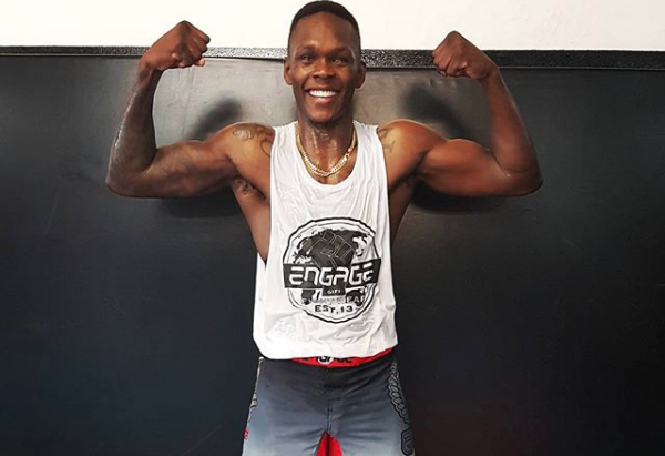 Image result for israel Adesanya and parents