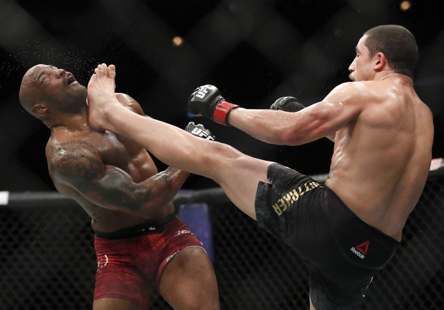 UFC: Robert Whittaker wins split decision over Yoel Romero - Romero