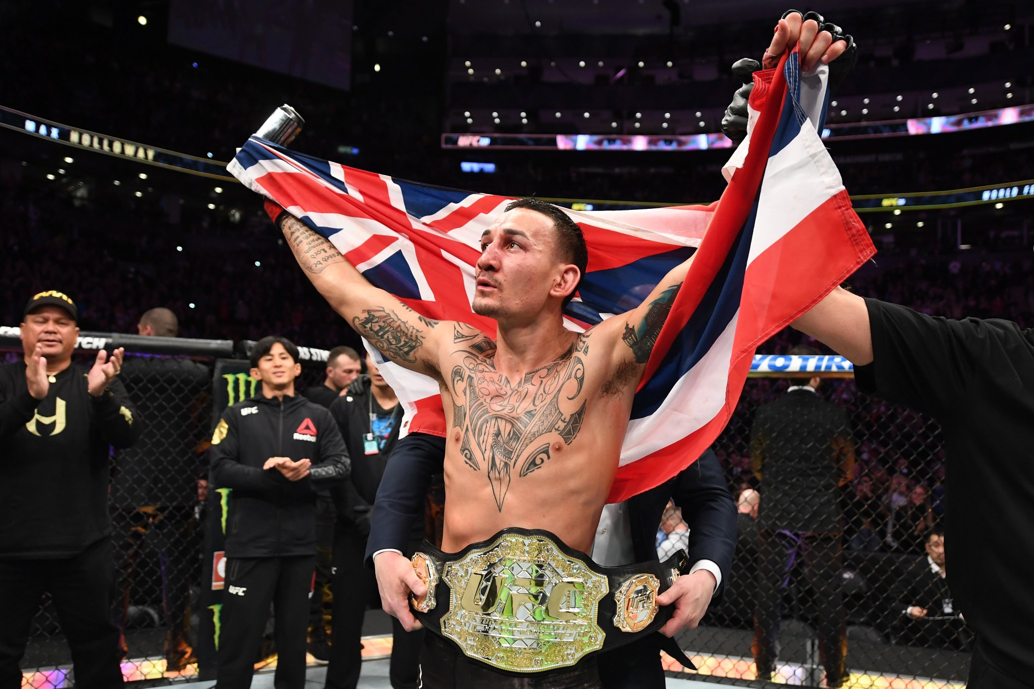 UFC 231 'Holloway vs. Ortega' Results - Holloway Batters Ortega in a Four Round War, Retains the Belt - holloway