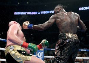 Tyson Fury resurrects like UNDERTAKER after getting knocked down cold in the 12th ROUND - Tyson