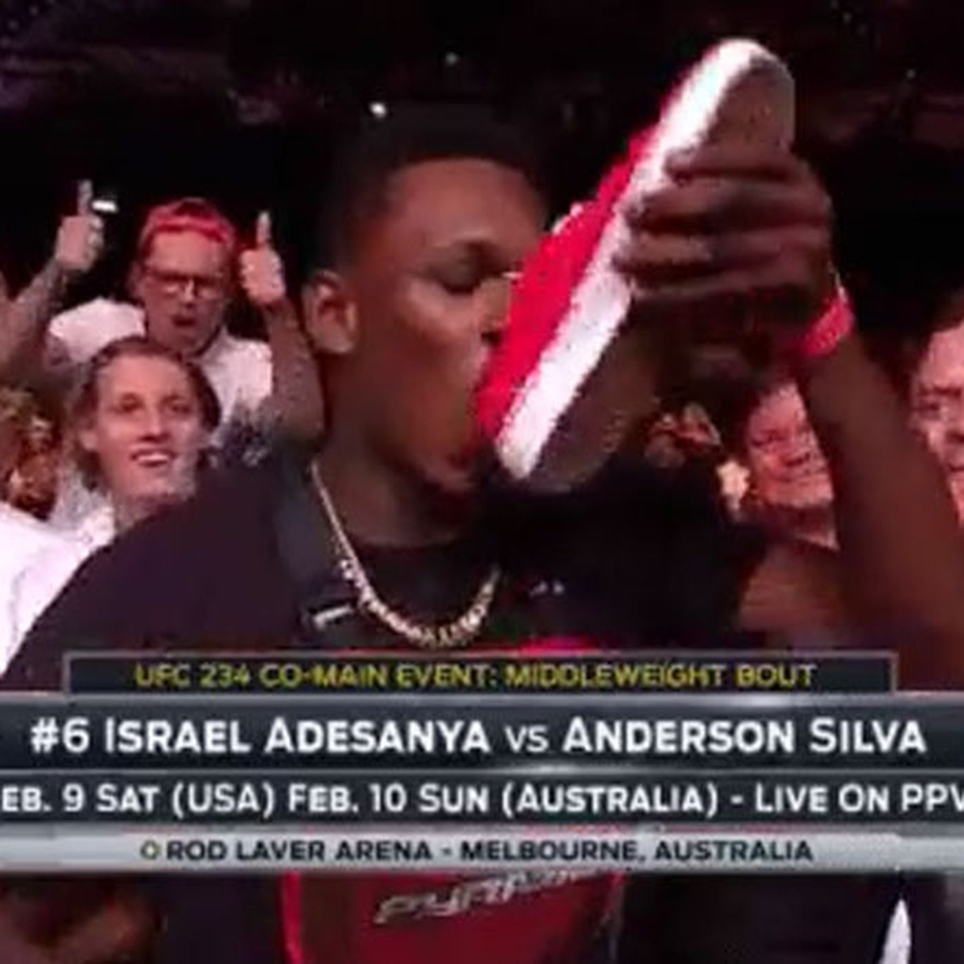 Israel Adesanya reveals what his mum texted him after he did a 'shoey' at UFC Adelaide -
