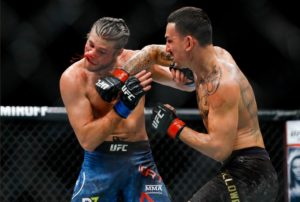 Twitter reacts to Max Holloway's BRUTAL stoppage victory over Brian Ortega - Max