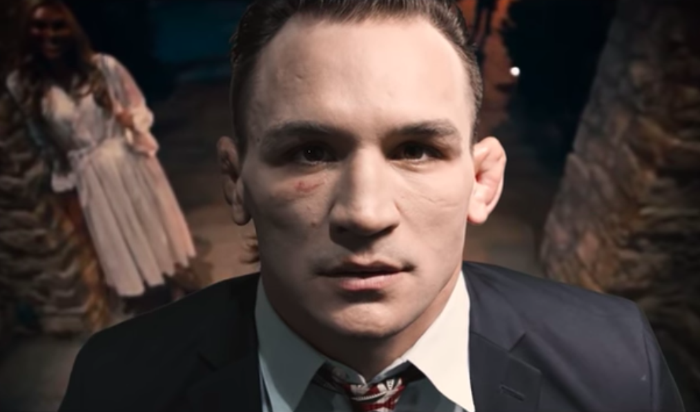 Michael Chandler re-enacts a chilling scene from the Purge to promote his Lightweight Title fight against Brent Primus -