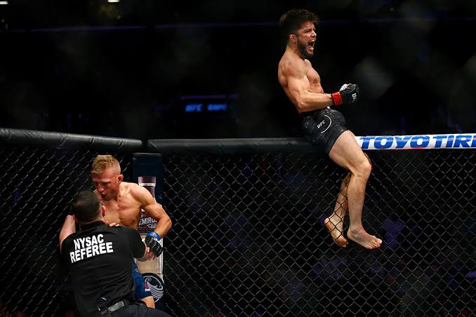 Cejudo celebrates his win over TJ