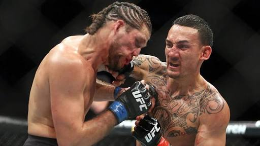 UFC: Watch: Max Holloway teaches Brian Ortega to keep his hands up amidst brutal 4th round beating - Holloway