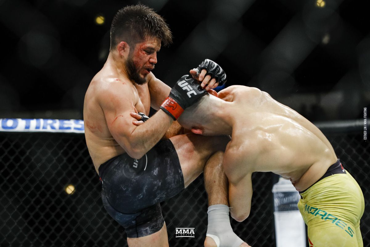 Marlon Moraes reacts to his TKO defeat to Henry Cejudo -