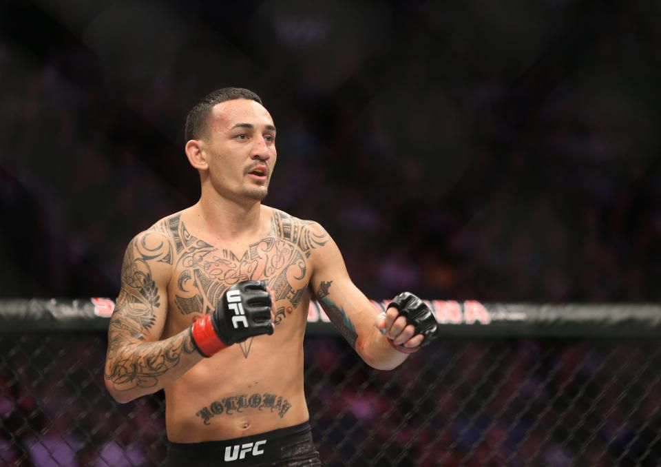 WATCH: Max Holloway opens a bottle cap with a spinning back kick -