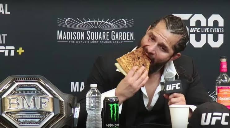 UFC: A pizza eating Jorge Masvidal holds court over the press after dominant BMF title win - Masvidal