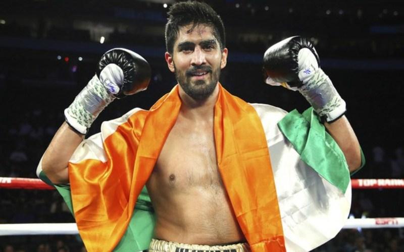 BREAKING NEWS: Vijender Singh knocks down Charles Adamu three times to win a UD - Vijender
