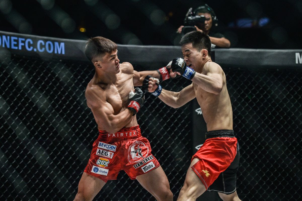 JOSHUA PACIO RETAINS ONE STRAWWEIGHT WORLD TITLE WITH A CLOSE SPLIT DECISION VICTORY OVER ALEX SILVA -