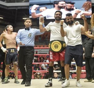Mujtaba Kamal with Arsad Asif Khan after hw won IBO Oceania title